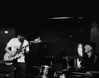 black and white photo of Yuji and drummer live at the Crows Nest first and third Wednesday night